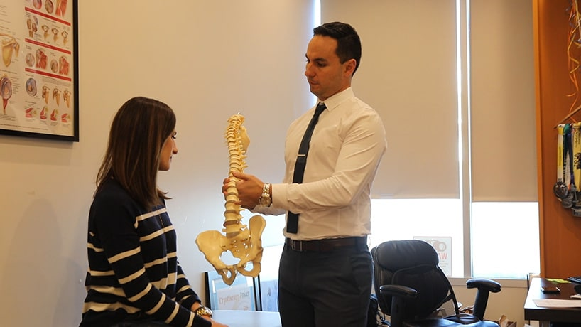 dr zaker chiropractor explaining slipped disc to patient