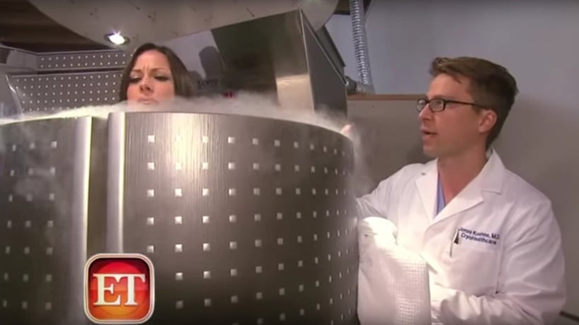 Doctor talking to a female patient inside of a Cryo-therapy machine