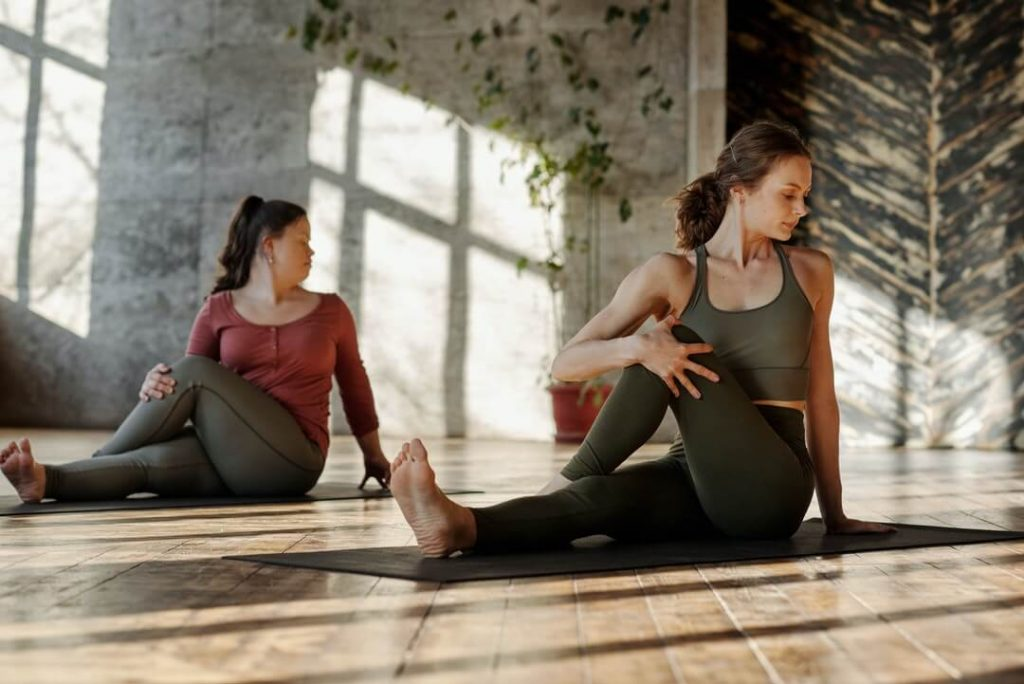 Two women doing stretching exercises
