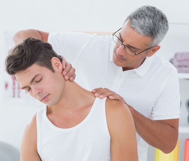 Physician helping a client with neck pain
