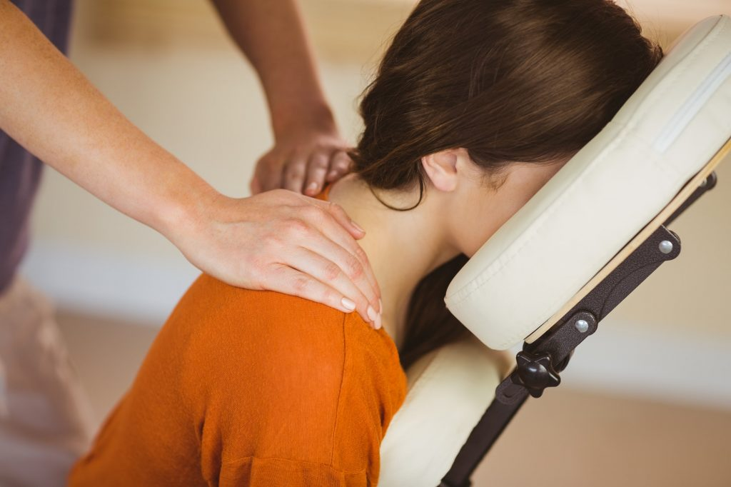 Young woman getting a neck massage