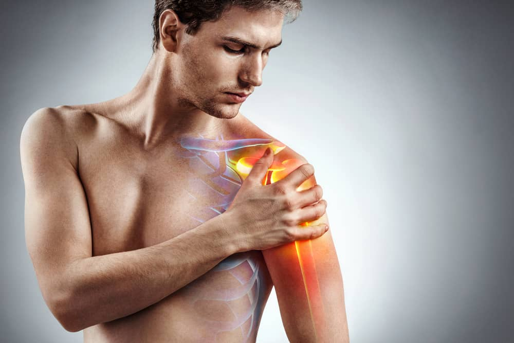 Animation of a young man holding his shoulder due to pain