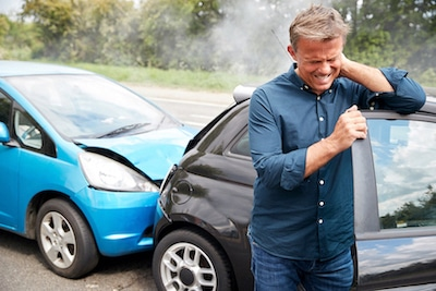 Man holding his neck due to a recent auto injury
