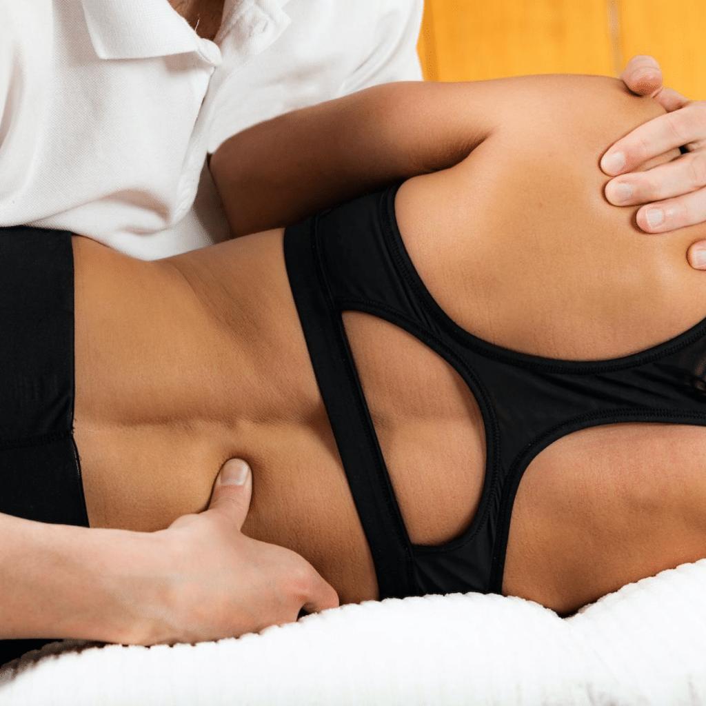 Chiropractor adjusting patients lower back