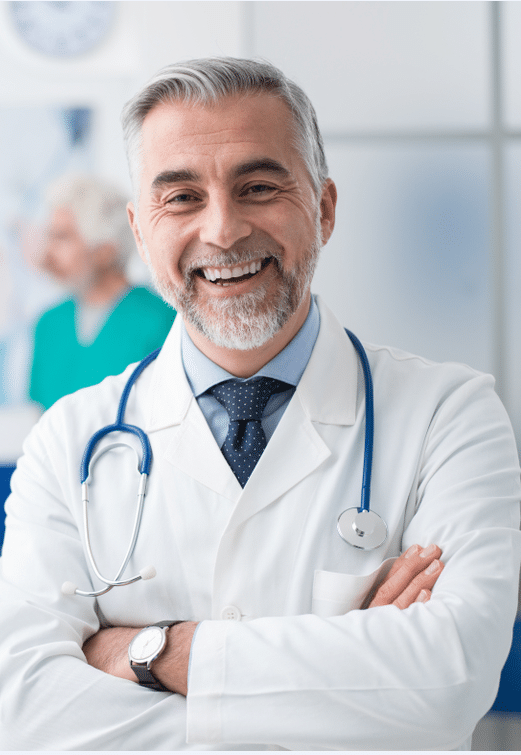 Photo of a pain management doctor smiling.