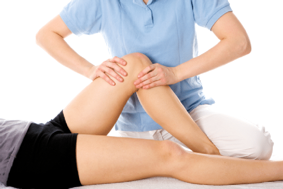 Chiropractor treating a patient with joint problem